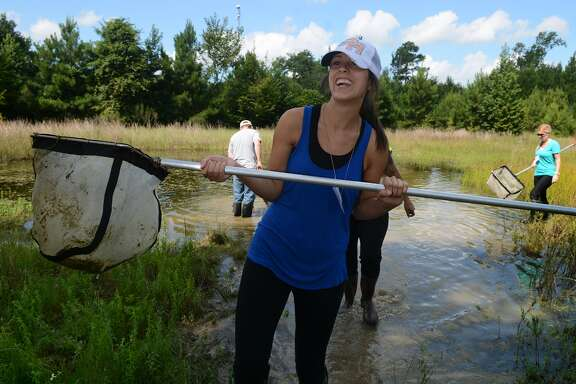Poe Elementary science teacher Madison Knisley, is all smiles after at a Little Cypress Creek Preserve wetland pond while on a Texas A&M University science teacher training workshop field trip.