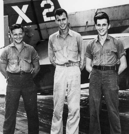 A young George Bush (center), Joe Reichert (L), Leo Nadeau (R) photographed December 31, 1942. Photo: ROBERT B. STINNETT NATL ARCHIVES, ARTS & ENTERTAINMENT NETWORK / HANDOUT
