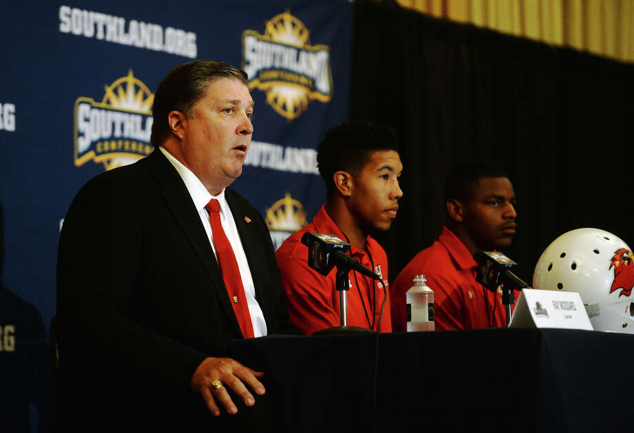 Coach Ray Woodard answers a question from the media during Wednesday's media day. The Southland Conference held their annual football media day at the L'Auberge Resort in Lake Charles on Wednesday. Lamar University was represented by Coach Ray Woodard, wide receiver Reggie Begelton, and defensive back Xavier Bethany.