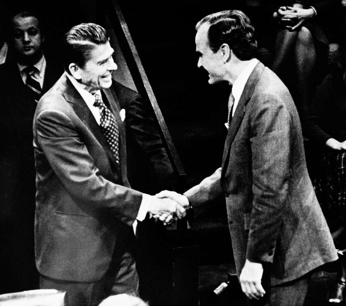 Republican presidential candidates Ronald Reagan, left, and George H.W. Bush, right, greet prior to their Thursday night debate February 28, 1980 on public television.