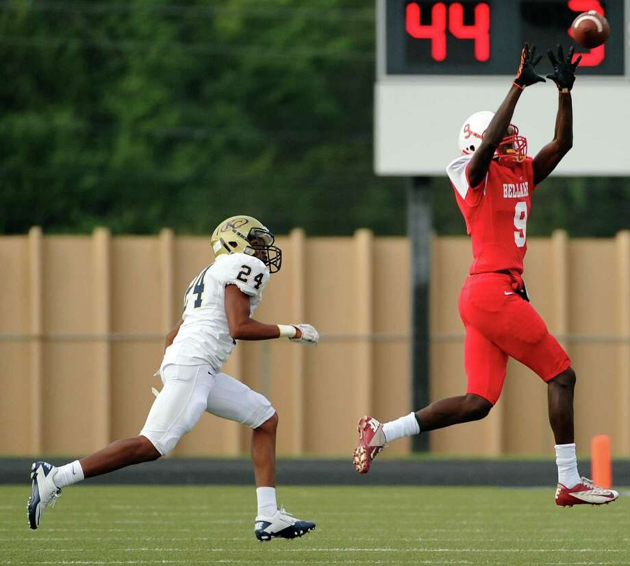 Bellaire wide receiver Courtney Lark, right, makes a touchdown reception as Klein Collins defensive back Davidson Daily looks on during the first half of a high school football game last fall. Photo: Eric Christian Smith, Freelance / 2014 Eric Christian Smith