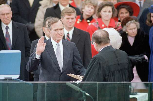 George H.W. Bush being sworn in as President of the United States. Photo: Ron Edmonds, Associated Press / AP