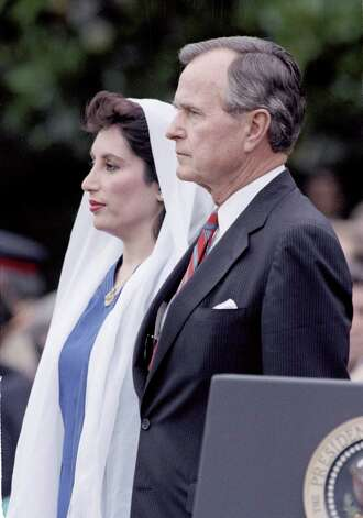 President George H.W. Bush and Pakistani Prime Minister Benazir Bhutto stand together during a welcoming ceremony on the grounds of the White House, in this June 6, 1989, Photo: Bob Daugherty, AP / AP