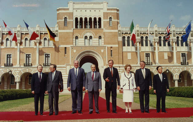 Leaders in the Economic Summit line up for the class photo at Rice following the day's meetings 07/09/1990. From left, EC President Jacques Delors, Itallian Prime Minister Giulio Andreotti, West German Chancellor Helmut Kohl, French President Francois Mitterand, US President George HW Bush, British Prime Minister Margaret Thatcher, Canadian Prime Minister Brian Mulroney, and Japanese Prime Minister Toshiki Kaifu. Photo: Nuri Vallbona, Houston Chronicle / Houston Post files
