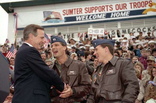"President Bush participates in the Sumter Community welcome to returning US troops. The President singles out two pilots for recognition, Capt. Dale Cormier and Lt. ""Neck"" Dodson,