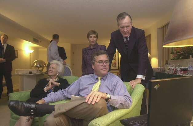 Florida Gov. Jeb Bush and his father, former President George Bush watch the election results Tuesday, Nov. 5, 2002 in a hotel room in Miami as his mother, Barbara, sits nearby and his wife Columba looks on. Photo: JOE BURBANK, AP / POOL ORLANDO SENTINEL