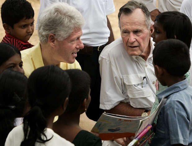 Former U.S. presidents Bill Clinton, left, and George H.W. Bush meet the media while inspecting rebuilding efforts for displaced residents from the December tsunami in Weligama, Sri Lanka Monday, Feb. 21, 2005. Photo: GERALD HERBERT, AP / AP