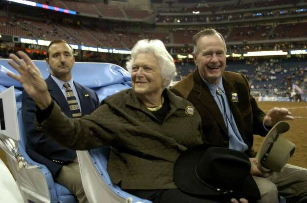 Former First Lady Barbara Bush, left, and former President George H.W. Bush are all smiles as they ride in the grand parade during the opening performance of the Houston Livestock Show and Rodeo March 1, 2005, at Reliant Stadium in Houston. Photo: BRETT COOMER, HOUSTON CHRONICLE / HOUSTON CHRONICLE