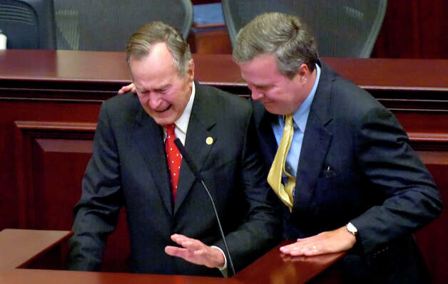 Former President George H.W. Bush, left, becomes emotional as he talks about how proud he was of the way his son, Florida Gov. Jeb Bush, right, handled his defeat in the 1994 race for governor, during a speech Dec. 4, 2006, at the Capitol in Tallahassee, Fl. Photo: COLIN HACKLEY, AP / TAMPA TRIBUNE