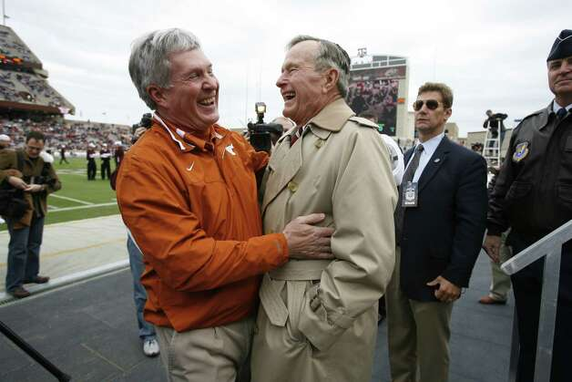 Texas head coach Mack Brown shares a laugh with former President George H.W. Bush before playing Texas A&M Nov. 23, 2007, at Kyle Field in College Station. Photo: Kevin Fujii, Houston Chronicle / Houston Chronicle