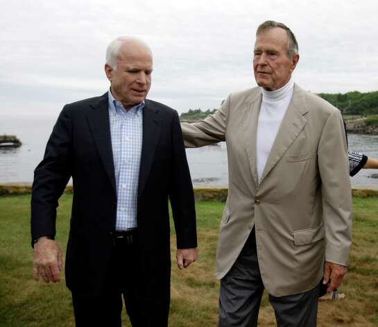 Republican presidential candidate Sen. John McCain, R-Ariz., and former President George H.W. Bush after a news conference at the Bush family home in Kennebunkport, Maine, Monday, July 21, 2008. Photo: Carolyn Kaster, AP / AP