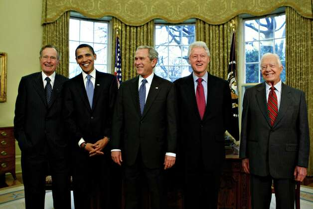 President-elect Barack Obama is welcomed by President George W. Bush for a meeting at the White House in Washington, Wednesday, Jan. 7, 2009, with former presidents, from left, George H.W. Bush, Bill  Clinton, and Jimmy Carter. Photo: J. Scott Applewhite, AP / AP