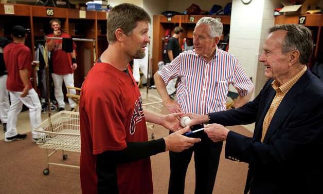 Former President George H.W. Bush signs an autograph for Houston Astros pitcher Doug Brocail as Bush tours the Astros clubhouse with team owner Drayton McLane prior to a spring training game against the Florida Marlins at Osceola County Stadium March 23, 2009, in Kissimmee. Photo: Smiley N. Pool, Houston Chronicle / Houston Chronicle