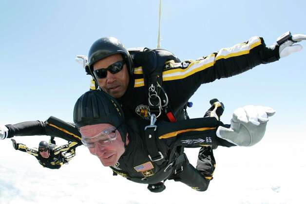In this photo provided by Army Golden Knights, former President George H. W. Bush, bottom, rides tandem with Sgt. Michael Elliott of the Army Golden Knights parachute team as he celebrates his 85th birthday with a parachute jump, Friday, June 12, 2009, in Kennebunkport, Maine. Photo: SSG Joe Abeln, AP / Army Golden Knights