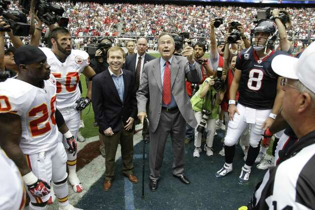 Former President George H.W. Bush flips the coin before an NFL football game between the Houston Texans and the Kansas City Chiefs at Reliant Stadium Sunday, Oct. 17, 2010, in Houston. The Texans beat the Chiefs 35-31. Photo: Brett Coomer, Houston Chronicle / Houston Chronicle