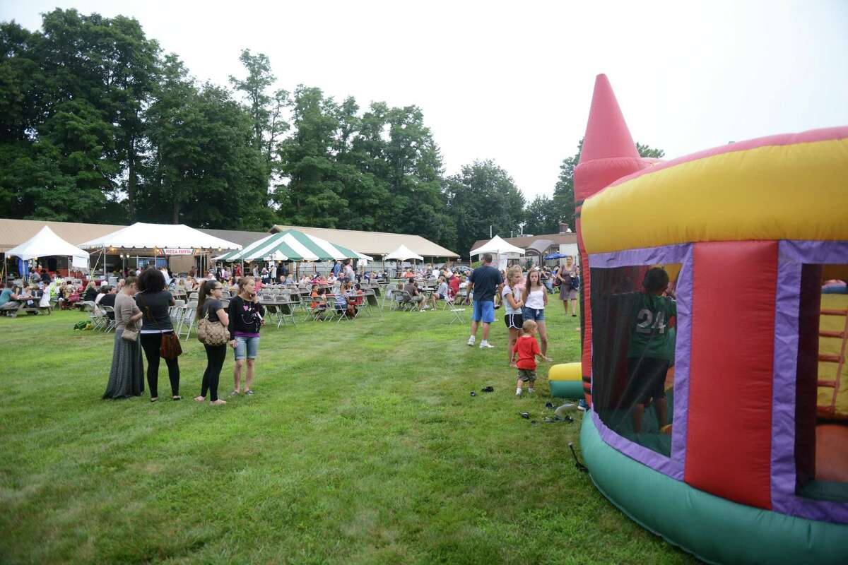 The annual Italian Festival at the Amerigo Vespucci Lodge in Danbury returns on Friday, July 31, for a full weekend of activities. Here, hundreds of guests enjoy the festival in 2014. The event will feature an array of authentic Italian food, live music, a classic car show and activities for children.