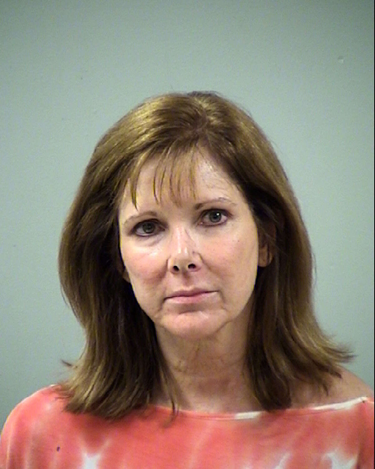 Karen Gallagher was arrested on a charge of driving while intoxicated following a crash Wednesday night on the North Side.