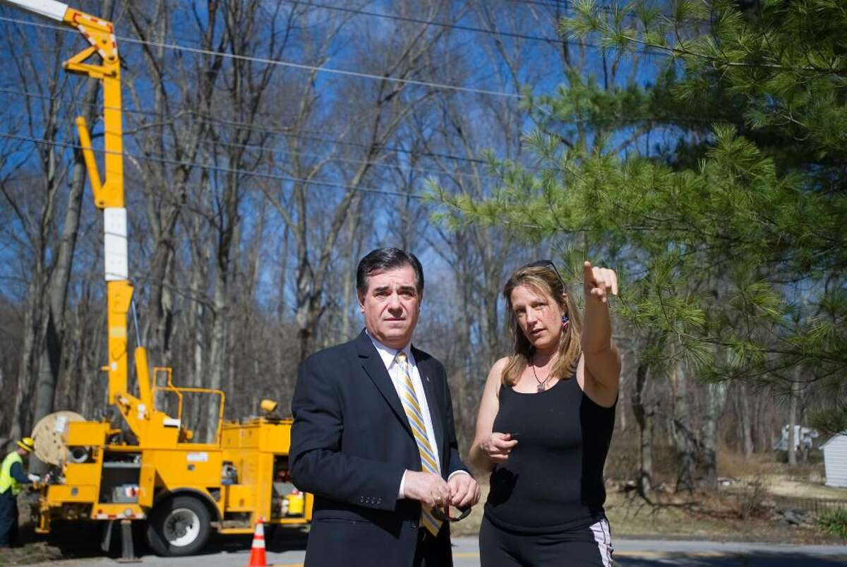 Stamford Mayor Michael Pavia talks to Susan Bolognino, a resident of Alpine Street, as he toured a Turn of River neighborhood to talk to residents and survey storm damage in Stamford, Conn. on Thursday, March 18, 2010.