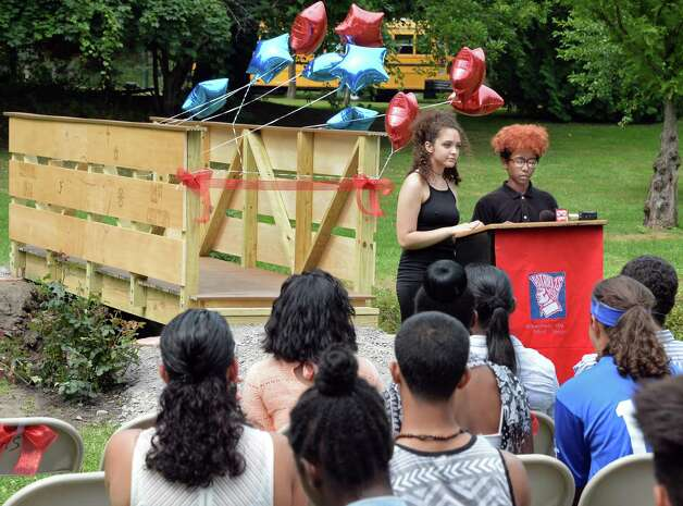 Schenectady High School students Mikayla Foster and Christopher Colon speak during ceremonies unveiling the bridge that students of the 21st Century Summer Learning Program designed and constructed on the 18th hole of the Disc Golf Course in Central Park Thursday July 30, 2015 in Schenectady, NY. (John Carl D'Annibale / Times Union) Photo: John Carl D'Annibale / 10032812A