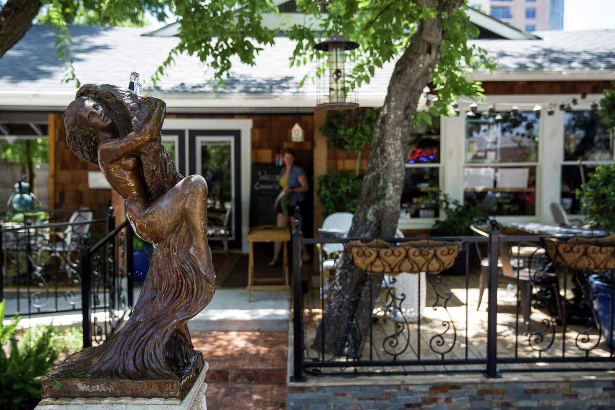 The entrance to CommonWealth Coffeehouse and Bakery includes a patio and a Parisian-style water fountain.
