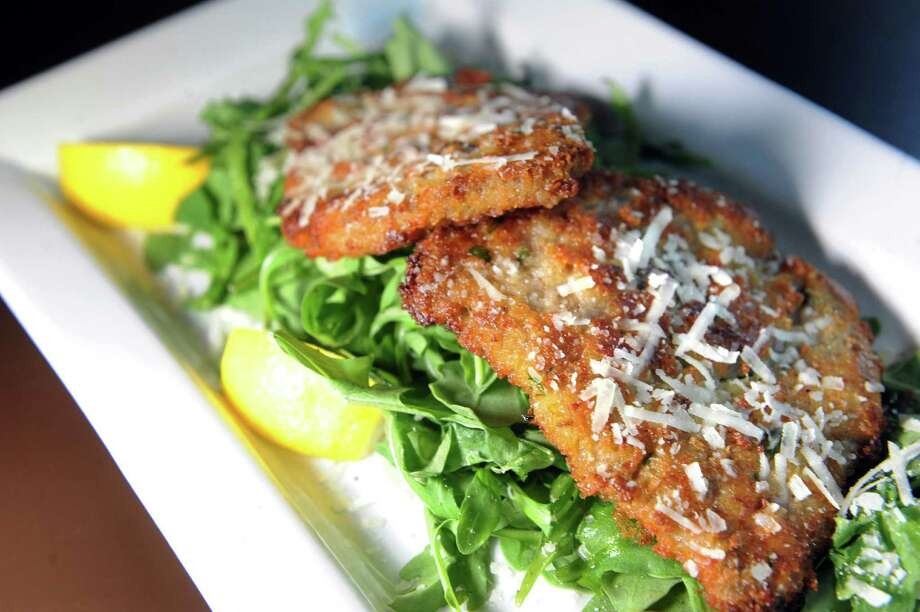 Sicilian Filet Mignon is thin-sliced filet, lightly pounded and breaded with parmesan and  served over arugula salad and topped with Pecorino Romano cheese on Thursday, July 23, 2015, at Max London's in Saratoga Springs, N.Y. (Cindy Schultz / Times Union) Photo: Cindy Schultz / 00032745A