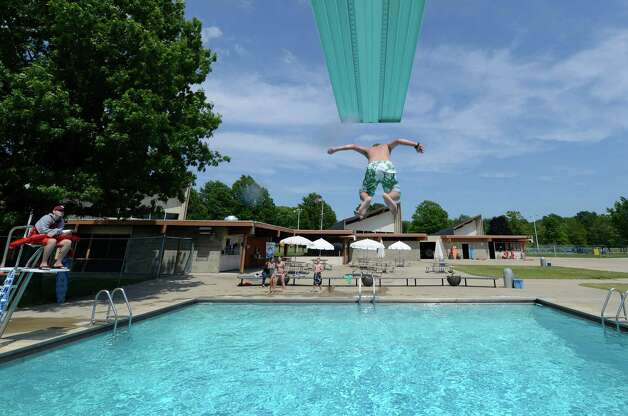Steven Hummel, 11, of Selkirk dives off the high board at the Elm Avenue Park pool in Bethlehem, N.Y. June 18, 2012. The Bethlehem Public Library, working with the town of Bethlehem, now provides WiFi access at the Elm Avenue Park pool complex. (Skip Dickstein / Times Union archive) Photo: SKIP DICKSTEIN