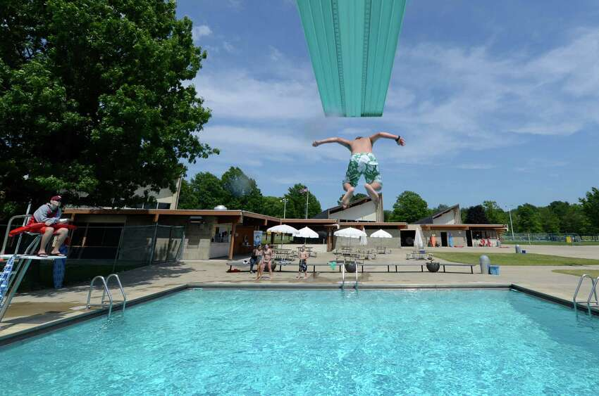 Steven Hummel, 11, of Selkirk dives off the high board at the Elm Avenue Park pool in Bethlehem, N.Y. June 18, 2012. The Bethlehem Public Library, working with the town of Bethlehem, now provides WiFi access at the Elm Avenue Park pool complex. (Skip Dickstein / Times Union archive)