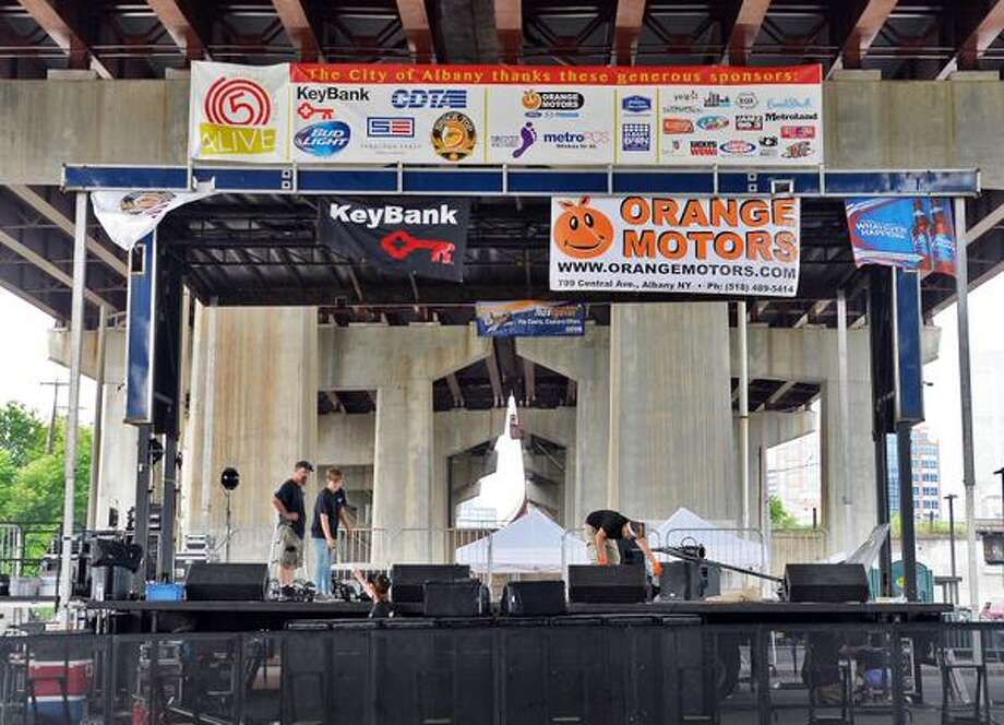 Threatening weather has crews erecting a stage at the Corning Preserve Boat Launch for the Alive at Five concert on July 30, 2015, in Albany, N.Y. (John Carl D'Annibale/Times Union)