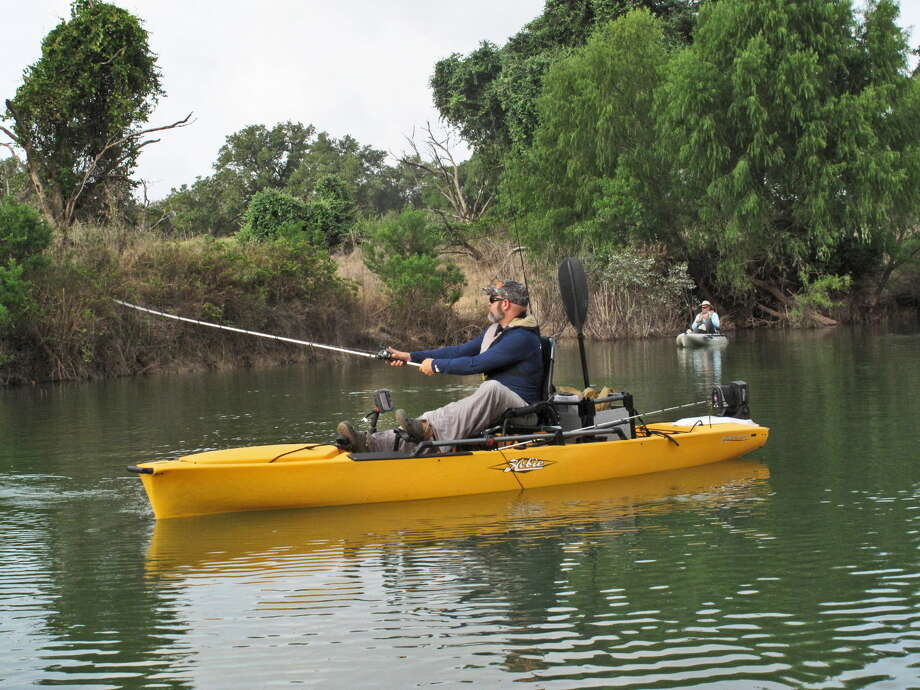 Cody Prather casts to the bank of Rebecca Creek a couple of hundred yards before it joins the Guadalupe River from a Hobie Mirage Pro Angler 14, his favorite kayak for tournaments because of its features and accessories. Photo: Photos By John Goodspeed /For The Express-News
