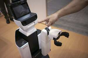 Toyota robot can pick up after people, help the sick - Photo