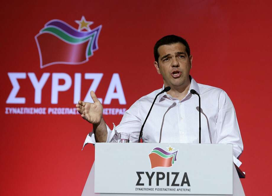 Greek Prime Minister Alexis Tsipras addresses a meeting of his ruling radical left Syriza party's central committee in Athens. Tsipras called for an extraordinary party congress in September, after Greece is expected to seal a new bailout deal with its international creditors, in a bid to end a rebellion by his hardline lawmakers that is threatening to topple his coalition government. Photo: Thanassis Stavrakis, Associated Press
