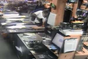 Sneaky gun store thief makes a dangerous grab - Photo