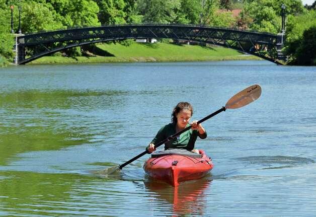 Anna Sheridan of Albany paddles a kayak around Washington Park Lake in Albany,NY, Tuesday June 4, 2013.  (John Carl D'Annibale / Times Union) Photo: John Carl D'Annibale
