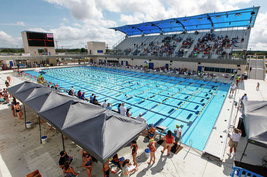 Swimmers take part in the inaugural Bexar County Games swimming competition at the Northside Swim Center on Saturday, July 19, 2013. The swim meet was the first competition held at the new outdoor stadium. Photo: Marvin Pfeiffer / San Antonio Express-News / Prime Time Newspapers 2013