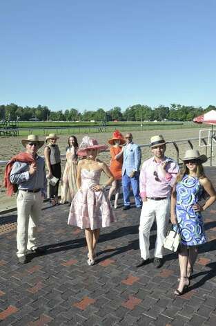 Left to right: Mick Rodgers, of Saratoga Saddlery, in a Lucchese shark-skin boots, Ariat jeans, Robert Graham dress shirt, Jared Lang sports coat and Outback Survival Gear Hat; Lyndsey Lowe, of Lifestyles, in a pant and tank outfit by Eileen Fisher, a wristlet by Shiraleah and hat by Scala; Jessica Hoesel, of Saratoga Sundress, wears a dress by X Taren; Chloe Aviza, of Fancy Schmancy, in an Aidan Mattox dress, shoes from Member, and hat by Fancy Schmancy; Shalyn Barakat, of Frivolous, wears a Stop Staring hat and a custom-label dress for Frivolous; Robert Amore, of Amore, wears a Ravazzolo blazer, private-label shirt to Amore and 34 Heritage trousers; James Galliher, of the National, wearing a Dobbs hat, Maui Jim sunglasses, Stone Rose shirt, Empire Clothiers blazer, Martin Dingman belt, Jeckerson slacks and Peter Millar loafers; Lauren Lis, of the Saddlery, in a Jude Connally dress, Acubra hat and Maui Jim sunglasses.  (Photo by Paul Buckowski Times Union)