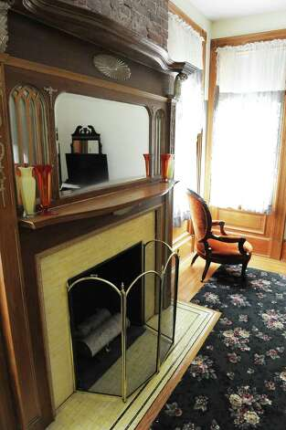 Fireplace in the yellow guest room on the second floor of Mike Chrys' house on the shores of Lake George Friday June 12, 2015 in Bolton Landing, NY.   (John Carl D'Annibale / Times Union) Photo: John Carl D'Annibale / 00032208A