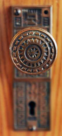 An original door knob in Mike Chrys' 19C house on the shores of Lake George Friday June 12, 2015 in Bolton Landing, NY.   (John Carl D'Annibale / Times Union) Photo: John Carl D'Annibale / 00032208A