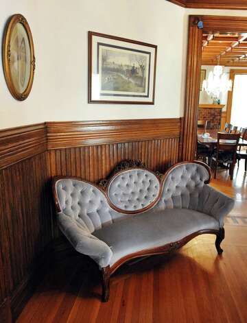 Victorian settee in the living room in Mike Chrys' house on the shores of Lake George Friday June 12, 2015 in Bolton Landing, NY.   (John Carl D'Annibale / Times Union) Photo: John Carl D'Annibale / 00032208A