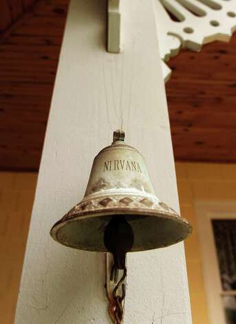 A bell on the second floor porch of Mike Chrys' 19C house on the shores of Lake George Friday June 12, 2015 in Bolton Landing, NY.   (John Carl D'Annibale / Times Union) Photo: John Carl D'Annibale / 00032208A