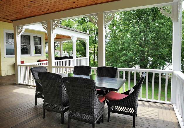 The second floor porch of Mike Chrys' 19C house on the shores of Lake George Friday June 12, 2015  in Bolton Landing, NY.   (John Carl D'Annibale / Times Union) Photo: John Carl D'Annibale / 00032208A