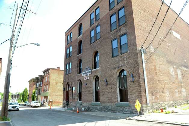 A view of the apartment building, Warehouse 71, located at 71 Canvass St. on Wednesday, July 22, 2015, in Cohoes, N.Y.  The Civil War-era warehouse is being turned into apartments.   (Paul Buckowski / Times Union) Photo: PAUL BUCKOWSKI / 00032700A