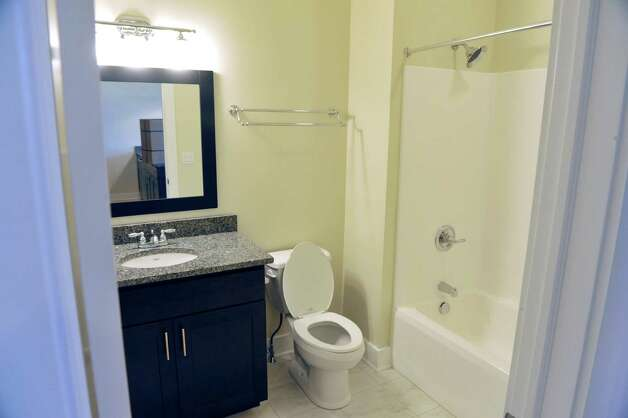 A view of bathroom inside one of the apartments at Warehouse 71, located at 71 Canvass St. on Wednesday, July 22, 2015, in Cohoes, N.Y.  The Civil War-era warehouse is being turned into apartments.   (Paul Buckowski / Times Union) Photo: PAUL BUCKOWSKI / 00032700A