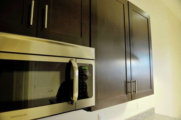A view of kitchen cabinets inside one of the apartments at Warehouse 71, located at 71 Canvass St. on Wednesday, July 22, 2015, in Cohoes, N.Y.  The Civil War-era warehouse is being turned into apartments.   (Paul Buckowski / Times Union) Photo: PAUL BUCKOWSKI / 00032700A