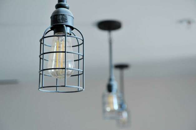 A view of the lighting fixtures inside one of the apartments at Warehouse 71, located at 71 Canvass St. on Wednesday, July 22, 2015, in Cohoes, N.Y.  The Civil War-era warehouse is being turned into apartments.   (Paul Buckowski / Times Union) Photo: PAUL BUCKOWSKI / 00032700A