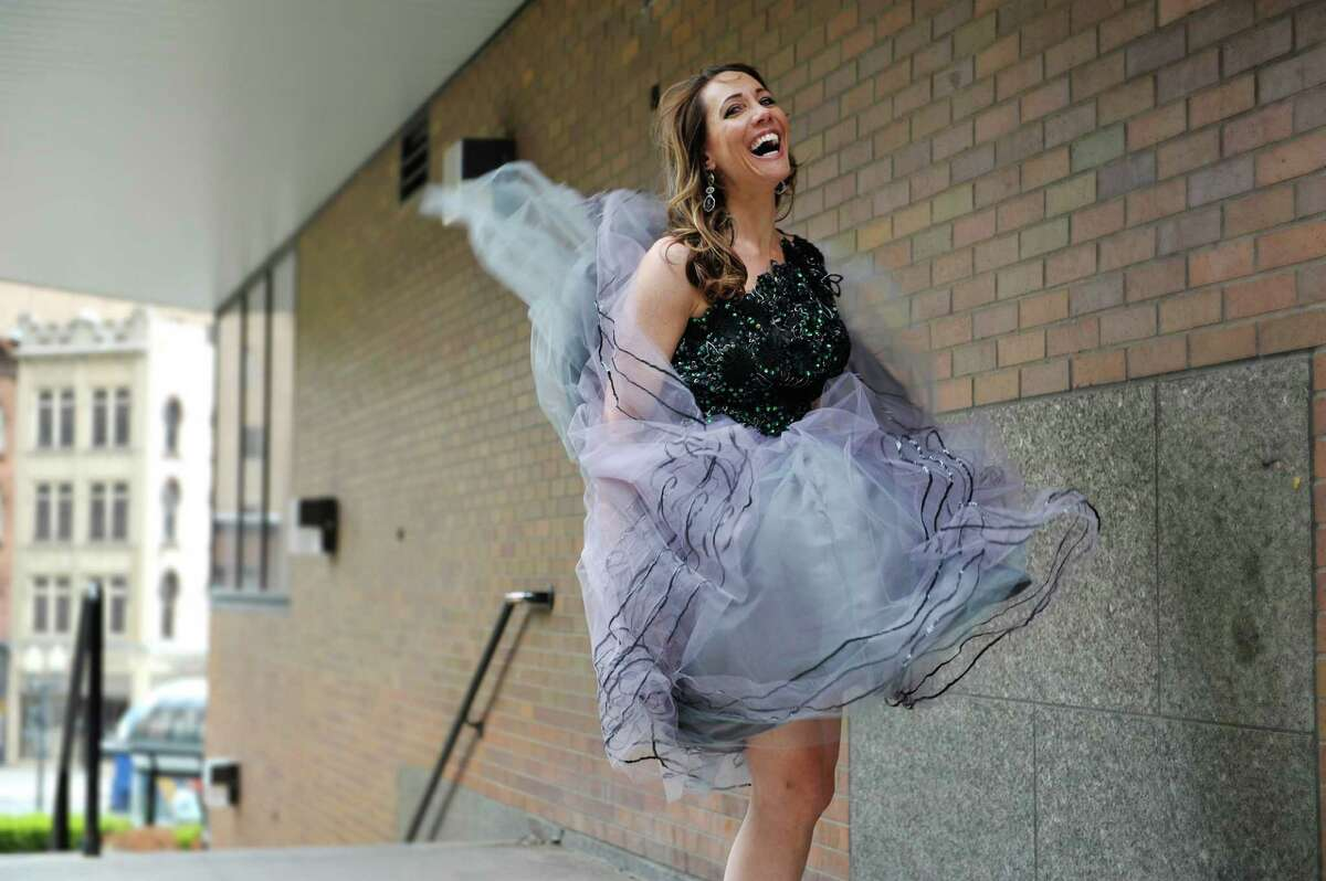 Jene Luciani says what is ?fashionable? depends on where you are. She's photographed wearing a Daniel Mozzes dress. ? Photo by Paul Buckowski Times Union