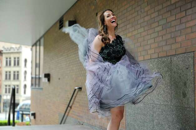 Jene Luciani says what is ?fashionable? depends on where you are. She's photographed wearing a Daniel Mozzes dress. ? Photo by Paul Buckowski Times Union Photo: PAUL BUCKOWSKI / 00031808A
