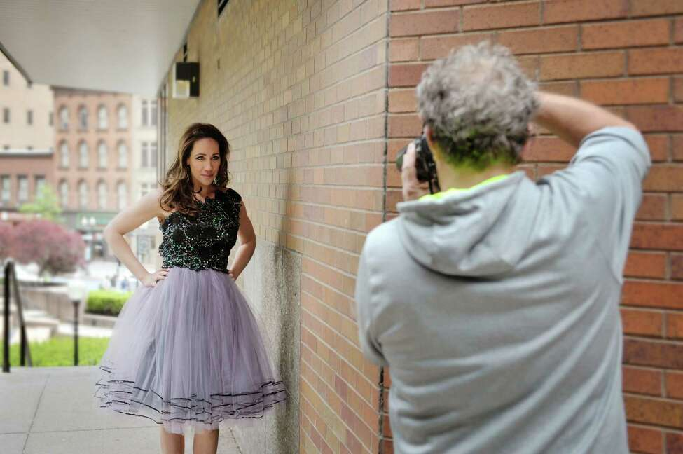 Photographer Dan Doyle takes photographs of Jene Luciani as she takes part in a fashion shoot for local designer Daniel Mozzes on Wednesday, May 13, 2015, in Albany, N.Y. (Paul Buckowski / Times Union)