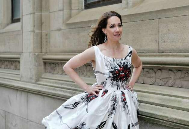 Jene Luciani says what is ?fashionable? depends on where you are. Luciani is wearing a Daniel Mozzes design. ? Photo by Paul Buckowski Times Union Photo: PAUL BUCKOWSKI / 00031808A