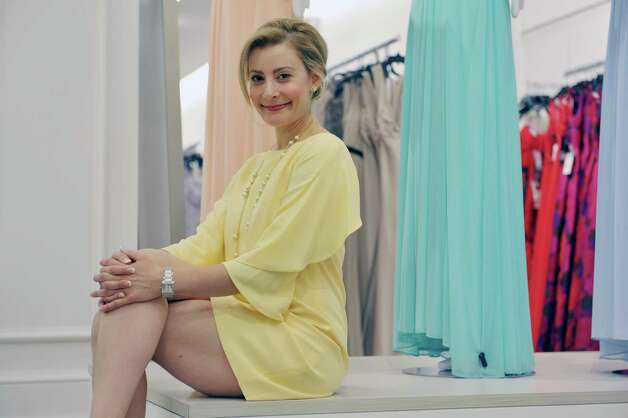 Blair Brodar, a fashion stylist and brand ambassador for Lord & Taylor, poses for a photograph at the Crossgates Mall store on Wednesday, May 20, 2015, in Albany, N.Y.  The dress, shoes and necklace that Brodar wears are all sold at Lord & Taylor.  (Paul Buckowski / Times Union) Photo: PAUL BUCKOWSKI / 10031837A