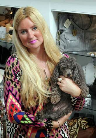 Eliza DeRocker with her dog LuLu owner of Saratoga Closet on Friday May 29, 2015 in Saratoga Springs, N.Y.  (Michael P. Farrell/Times Union) Photo: Michael P. Farrell / 00031984A